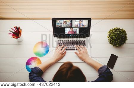 Caucasian woman using laptop for video call, with smiling diverse high school pupils on screen. communication technology and online education, digital composite image.