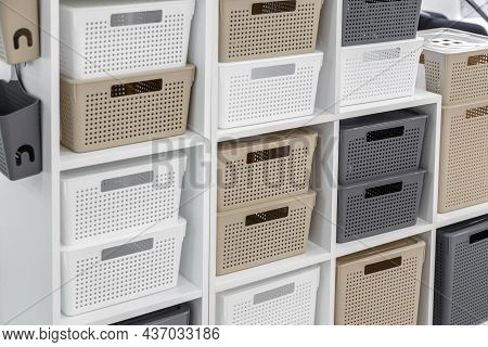 Plastic Container Boxes On A Shelf On A Rack For Organizing Home Space And Storing Things, Order And