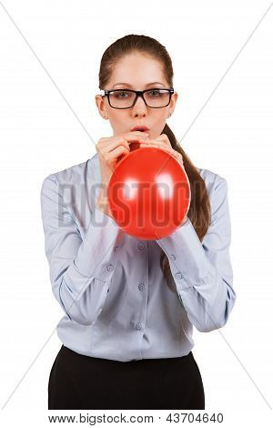 Girl With Glasses Inflating A Red Ball