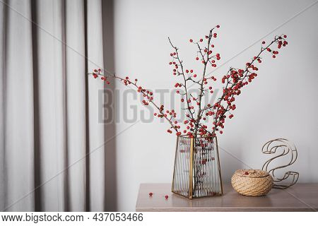 Hawthorn Branches With Red Berries In Vase, Decorative Letter And Wicker Box On Wooden Table Indoors