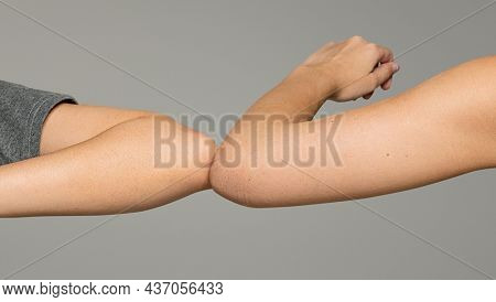 New normal greeting with elbow bumps for personal hygiene