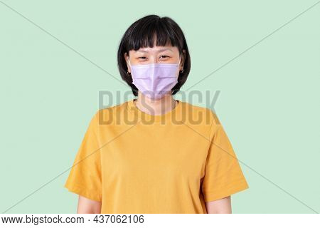 Asian woman wearing face mask in the new normal