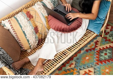 Woman hands using laptop wfh in the new normal