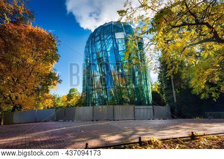 Gdansk, Poland - October 18, 2021: Glass palm tree house in the autumnal park of Gdansk Oliwa. Poland