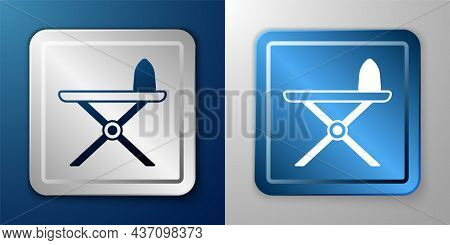 White Electric Iron And Ironing Board Icon Isolated On Blue And Grey Background. Steam Iron. Silver