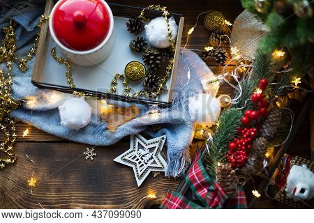 Christmas Decor By The Window On A Cozy Wooden Windowsill With A Mug With A Drink And A Cookie Jar.