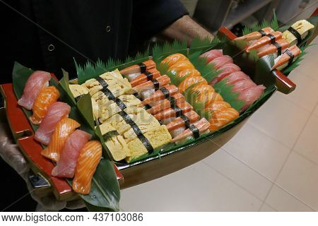 Multi Selection Of Japanese Food Sushi Rolls In A Boat, Includes Salmon, Tuna, Crab, Shrimps Etc.