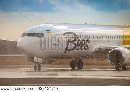 Bees Airline Yellow Plane On The Apron. Boeing 737-800 Ur-uba Passenger Aircraft. Ukraine, Kyiv - Ma