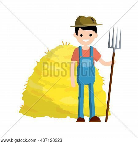 Farmer In Blue Jumpsuit And Hat With Fork In Hands. Yellow Haystack. Production Of Natural Food. Vil