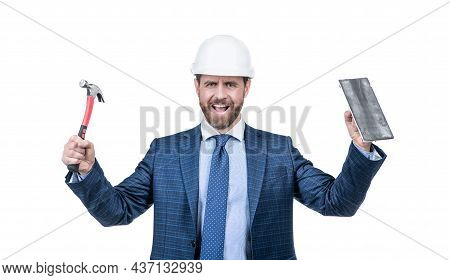 Happy Construction Man Wear Safety Helmet With Formal Suit Holding Hammer And Trowel, Building