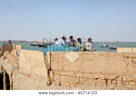 Fishermen Mending Nets At Bet Dwarka