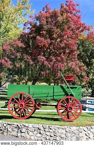 OAK GLEN, CALIFORNIA - 10 OCT 2021: Colorful wagon and Fall Foliage at the entrance to Los Rios Rancho, Southern Californias largest Apple Farm.