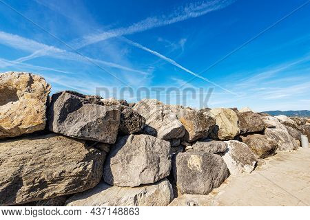 Closeup Of A Breakwater Or Groyne Made Of Giant Boulders By The Sea, Port Of The Small Lerici Villag
