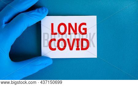 Covid-19 Long Covid Symbol. Words Long Covid On White Card. Doctor Hand In Blue Glove. Beautiful Blu