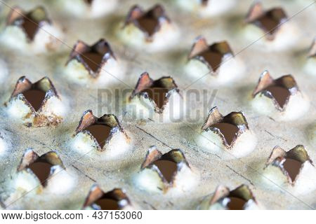 View Of The Sharp Corners Of The Holes Of One Of The Surfaces Of A Stainless Steel Metal Grater For