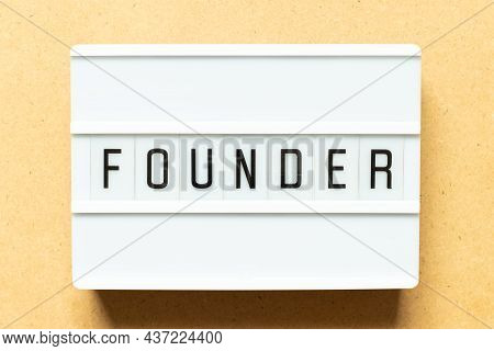 Lightbox With Word Founder On Wood Background