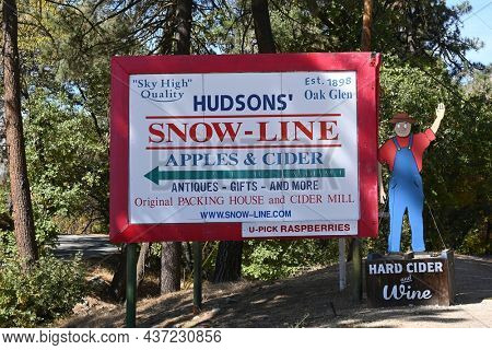 OAK GLEN, CALIFORNIA - 10 OCT 2021: Sign at Snow-Line Orchard, a family owned apple farm, winery and cidery.