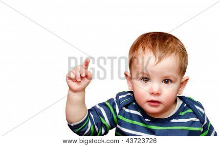 Portrait of beautiful boy pointing finger. Isolated