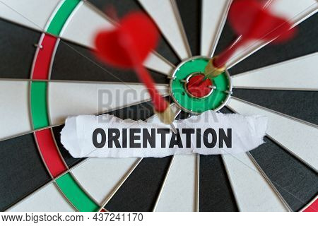 Target. The Picture Shows A Target, Darts And A Torn Piece Of Paper With The Inscription - Orientati