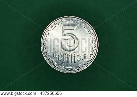 White Ukrainian Coin Five Kopecks  On A Green Background