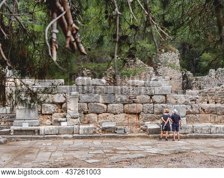 Phaselis, Turkey - May 19, 2018. Tourists On Agora, Ruined Market Square In Ancient Phaselis City. F