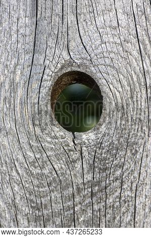 Old Weathered Wood Background With Hole For Design