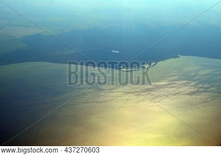 Aerial view of countryside from airliner. Dnepr River. 5 August 2021. Flight Dalaman-Kiev