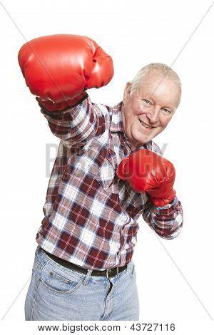 Senior Man Wearing Boxing Gloves Smiling