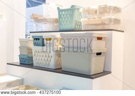 Plastic Containers On A Shelf For Organizing Home Space, Order And Interior, Sale Of Household Goods