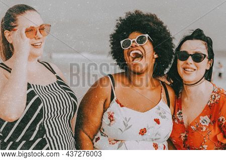 Plus-sized women laughing, summer vacation at the beach
