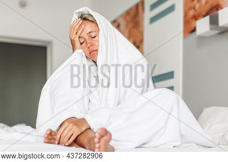 Sleepless middle-aged woman lying in bed suffers from insomnia sleep disorder cant sleep till morning, depressed middle aged sad female with close eyes at bedroom
