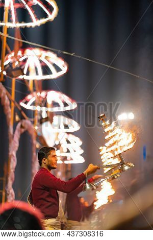 17.12.2019, Varanasi, India. Sacred Religious Ceremony Arati In The Temple. A Group Of Men Burn Ince