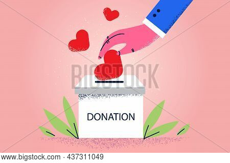 Donation Box And Love Concept. Human Hand Putting Red Hearts To Donation Box With Lettering For Need