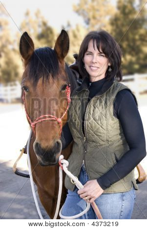 Attractive Dark Haired Woman And Pretty Bay Horse Portrait