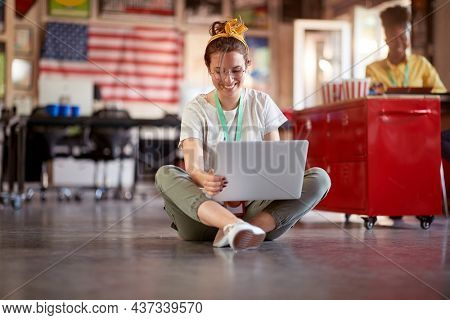 Young employee casually working at the office; Casual workspace concept