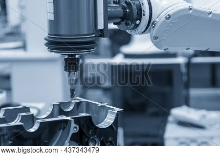 The Automotive Parts Finishing Process By Milling Process Attached The Robotics Arm. The Hi-technolo