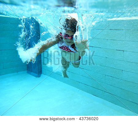 Happy little swimmer girl with bubbles