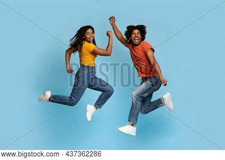 Emotional African American Lovers Showing Positive Emotions And Gesturing