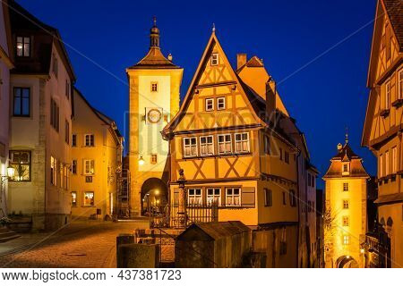 Plonlein square in Rothenburg ob der Tauber at night, Germany. German cityscape