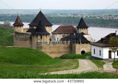 Medieval fortress with towers and defensive walls in the Hotin. Ukraine poster