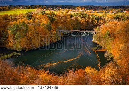 Autumnal scenery and the railway bridge in Rutki, Kashubia. Poland