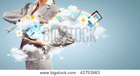 Business woman holding alarmclock