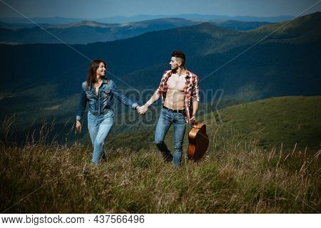 Young Couple In Love Spends Time Together. Young Couple Camping. Lovers Tourist Walking. Young Touri