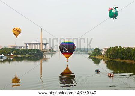 PUTRAJAYA, MALAYSIA - MARCH 2013 - One of the hot air balloon hovers over the river surface on March
