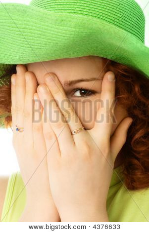 Cheerful Girl Closing Her Face With Hands