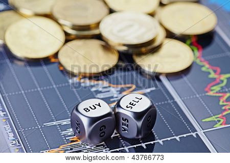 Dices Cubes With The Words Sell Buy Ahn Golden Coins On Financial Chart As The Background. Selective