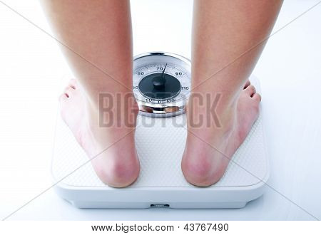 woman on a bathroom scale