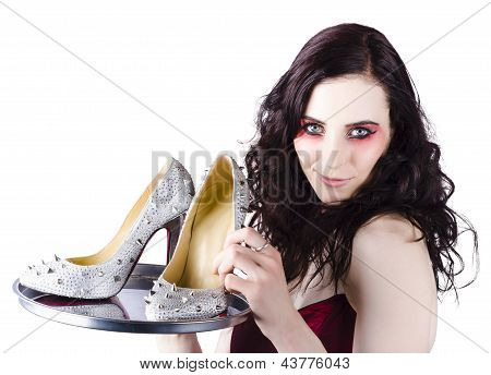 Pretty Woman Selling Shoes On Silver Plate