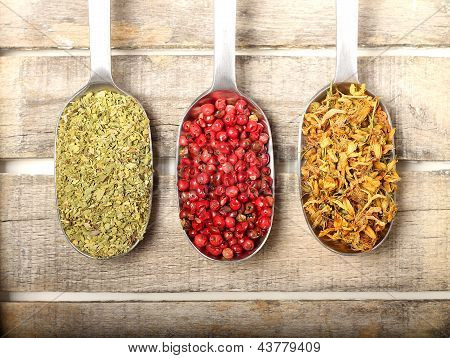 Condiments On Wooden Background