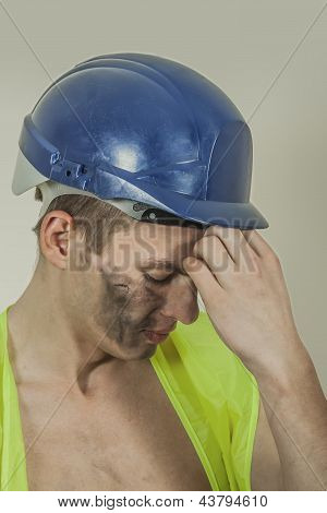 Stressed Worker With A Headache.